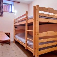 Chambre avec lits surperposés de la Pointe du Jour, appartement 8838 pour 4 personnes