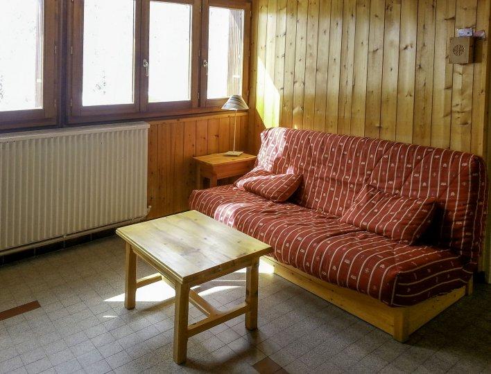 Chalet Les Heuvières - Appartement à Ceillac - Coin salon avec canapé couchage deux personnes