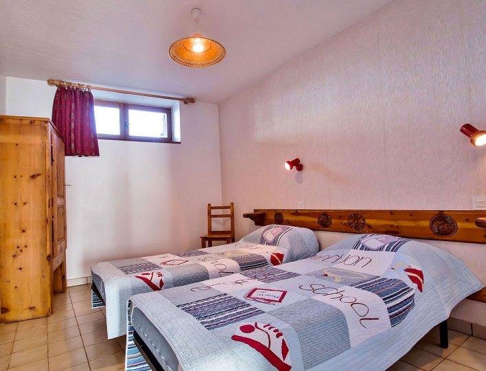 Chambre avec deux lits simples de la Pointe du Jour, appartement 8837 pour 4 personnes